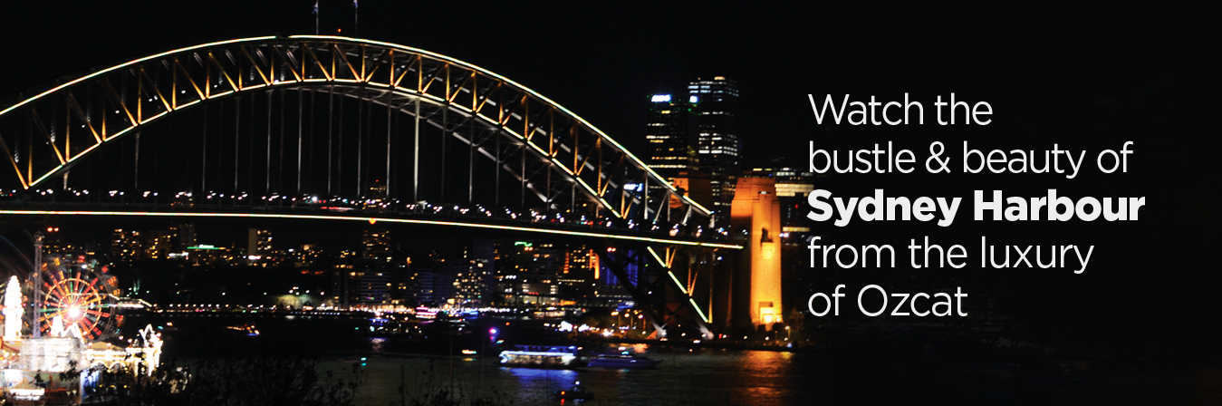 Watcch the bustle & beauty of Sydney Harbour from the luxury of Ozcat